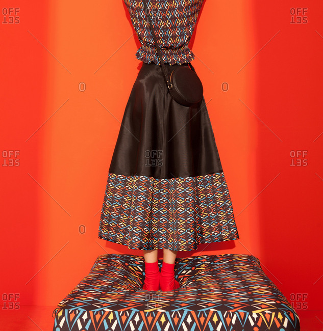 Model wearing colorful pattern skirt and shirt