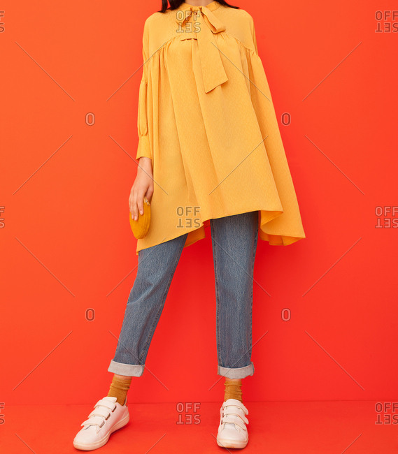 Model wearing a long yellow shirt