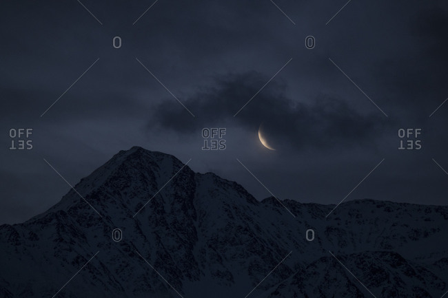 Tyrol - June 27, 2018: Crescent moon above the Hocheder.