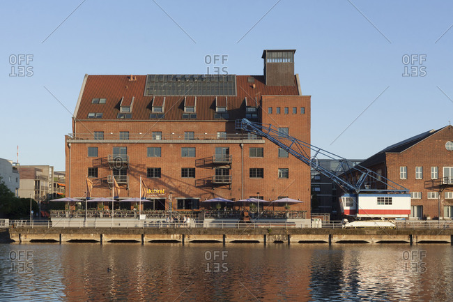 Werhahn mill and the building 'Faktorei 21', historic industrial architecture at the Innenharbour, Duisburg, Ruhr area, North Rhine-Westphalia, Germany, Europe