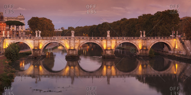 Angel Bridge reflected in the Tiber at sunset, Rome, Lazio, Italy