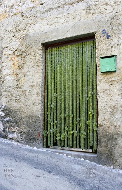 Croatia - June 28, 2018: Croatia, Kvarner Bay, Krk Island, Baska, old town, House entrance, Door curtain