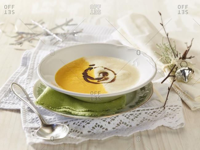 Two-colored pumpkin celery cream soup