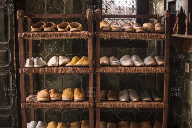 Morocco, Quarzazate, travel along road N9, shoes on a shelf
