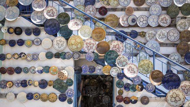 Morocco, Vallee du Paradis, souvenir shop, handicrafts, ceramic plates,