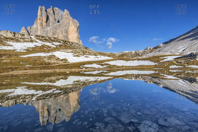 Tre Cime di Lavaredo  /  Drei Zinnen reflected in a mirror of water towards the lavaredo fork, Auronzo di Cadore, Belluno, Veneto, Italy