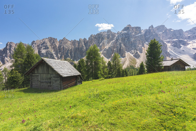 Wooden hut in Medagles alp with Puez group on the background, Dolomites, Lungiaru / Campill, San Martin de Tor, Bolzano, South Tyrol, Italy