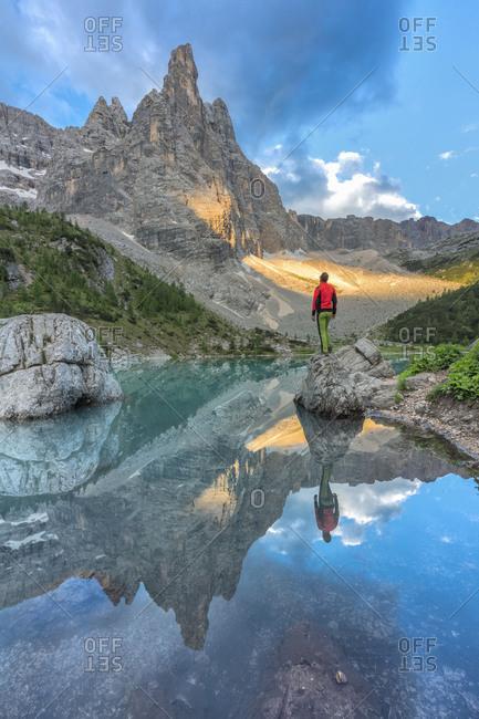 Dito di Dio (Finger of God) reflected in the turquoise water of Sorapiss lake, Dolomites, Cortina d' Ampezzo, Belluno, Veneto, Italy