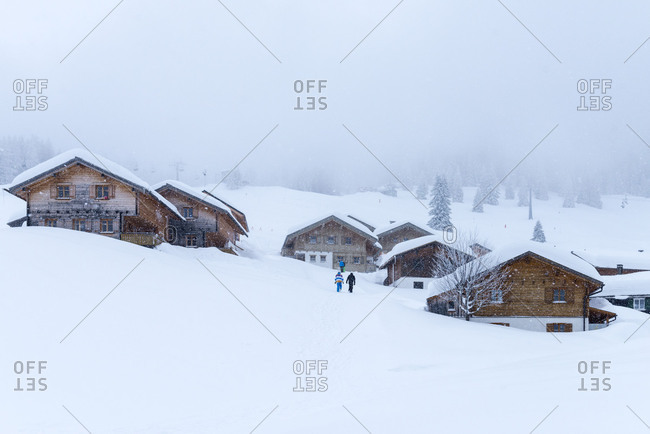 Austria, Montafon, St. Gallenkirch, snow-covered ski huts in the alpine village Garfrescha.