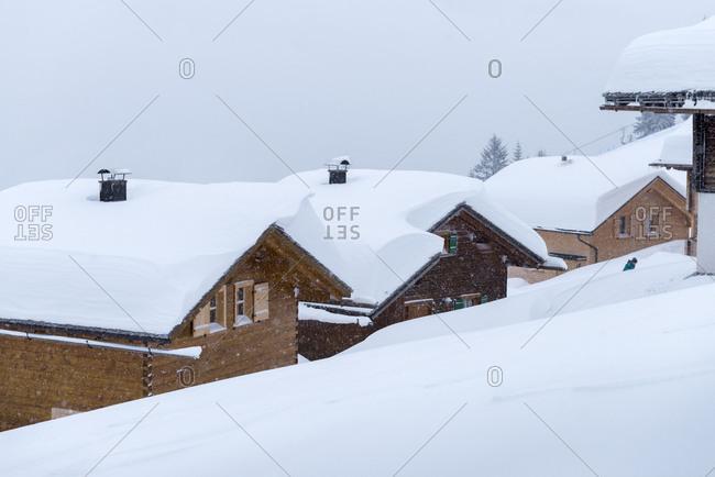 Austria, Montafon, St. Gallenkirch, snow-covered ski huts in the alpine village Garfrescha.
