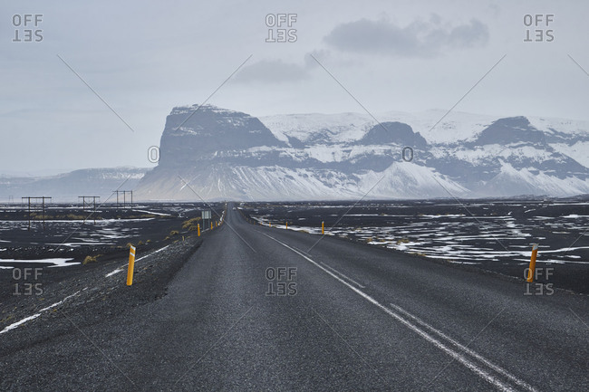 road through icelandic mountains covered in snow, east fjords, Road no 1