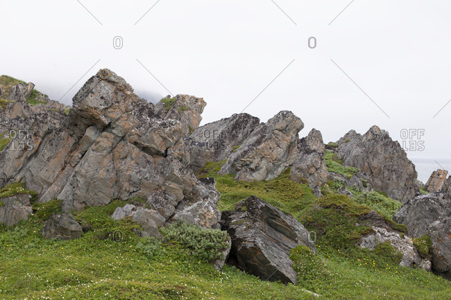 Norway - August 31, 2018: Cliffs and Arctic Ocean Landscape, Berlevag, Finnmark, North Norway