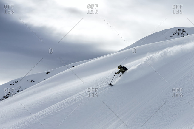 Man off-piste skiing