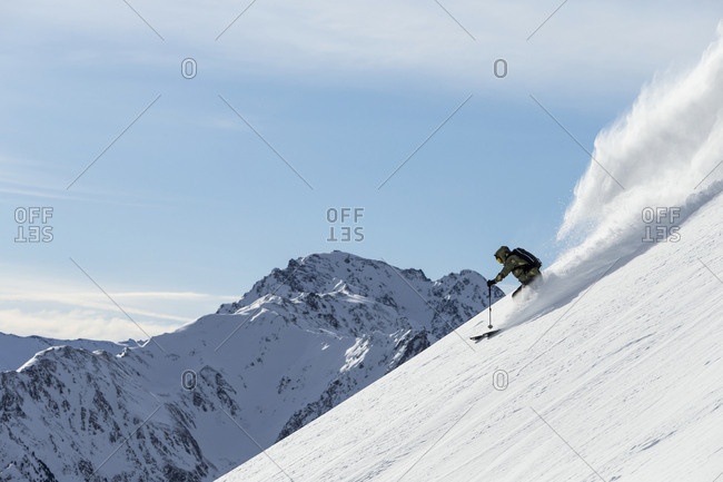 Man off-piste skiing in mountains