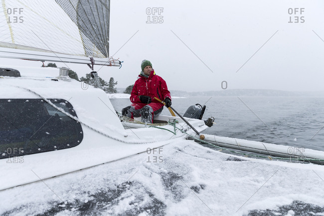 Man yachting on snowy day