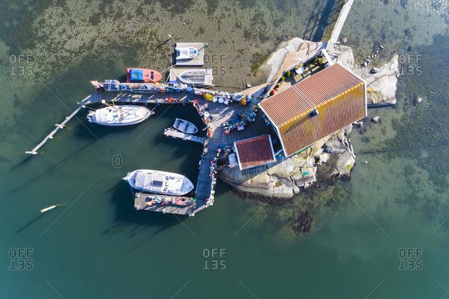 Boats moored at rocky island