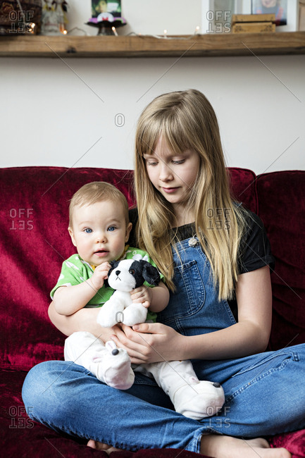 Girl with baby sister