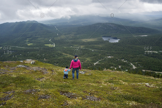 Mother hiking with toddler - Offset
