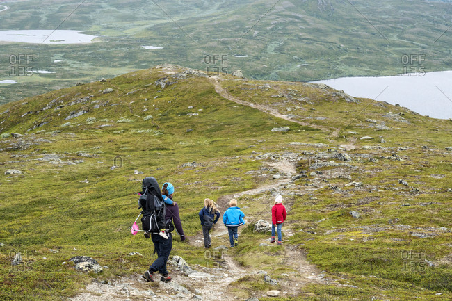 Mother with children hiking - Offset
