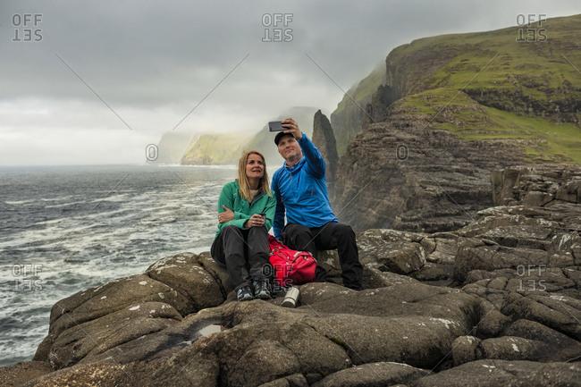 Hikers at coast taking selfie