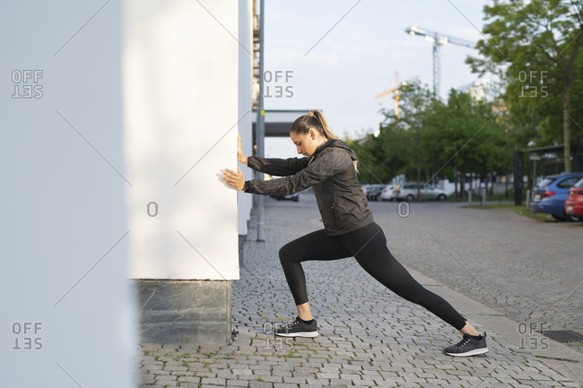 Woman outside stretching before a run