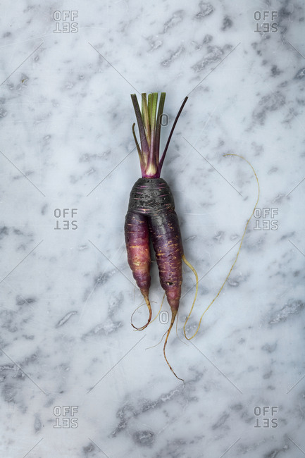 Root vegetable on marble background