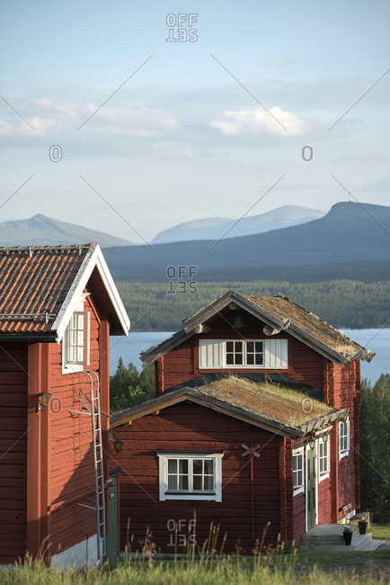 Wooden houses at lake - Offset