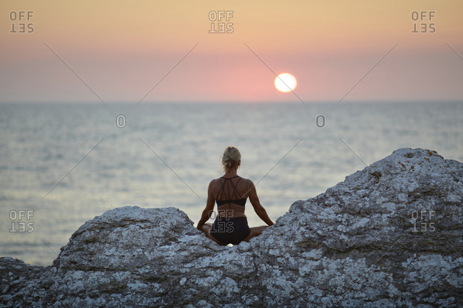 Woman meditating at sea