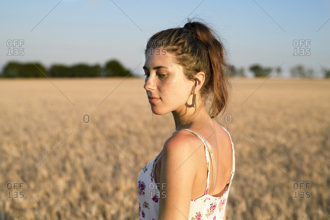 Young woman standing in wheat field