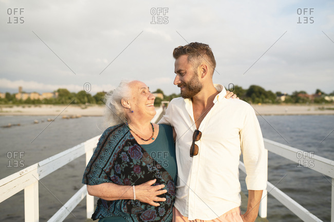 Grandmother and grandson enjoying a sunny afternoon at the beach