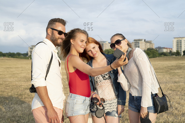Family taking a group selfie outside