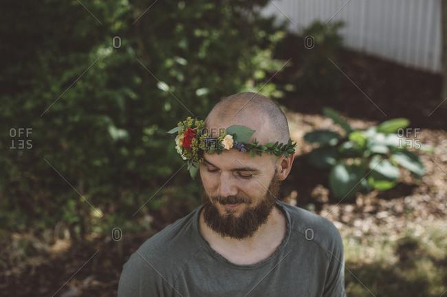 Bearded man wearing wreath