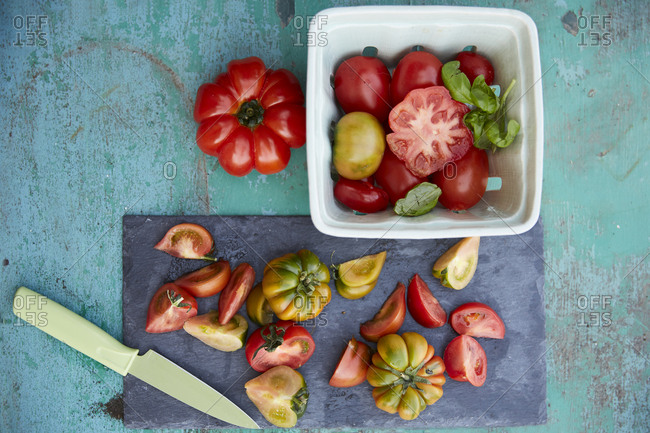 Fresh tomatoes on cutting board and in bowl