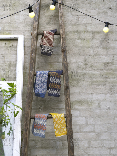 Knitted socks hanging on ladder