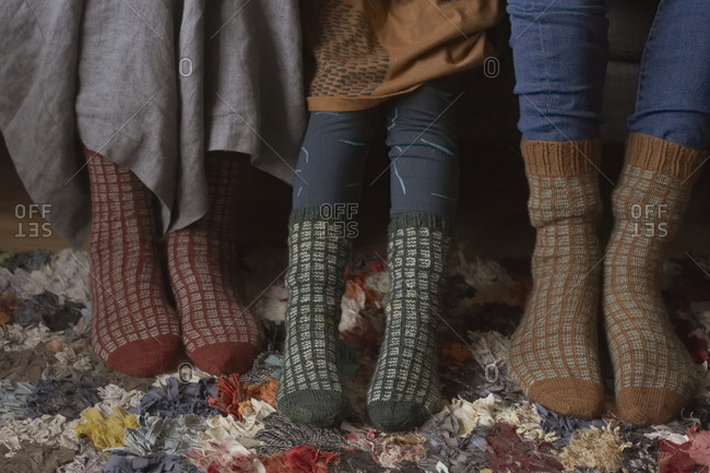 Three women wearing wooly socks