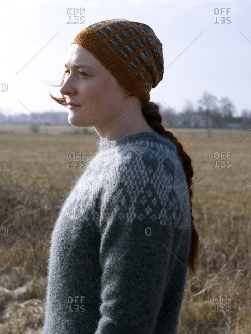 Woman wearing wooly hat and sweater