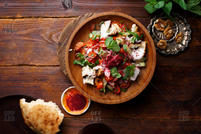 Middle eastern fattoush salad with bread, labne and greens