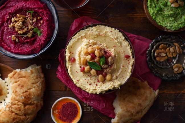 Israeli cuisine: hummus variety, fattoush, baba ganoush, flat bread