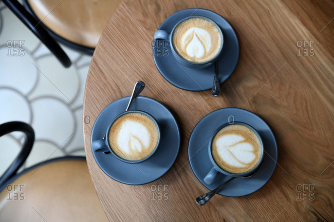 Three cups of coffee with latte art