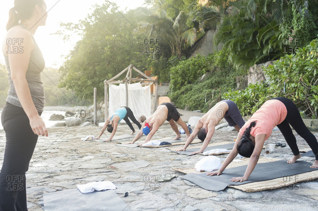 Mexico- Mismaloya- instructor with yoga class at ocean front