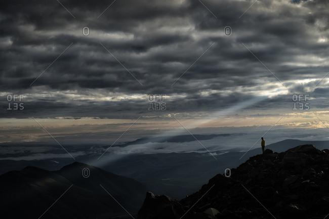Russia- Upper Baksan Valley- Caucasus- Mount Elbrus- Mountaineer looking down from North Camp