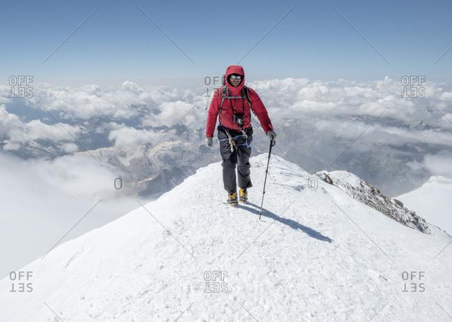 Russia- Upper Baksan Valley- Caucasus- Mountaineer ascending Mount Elbrus