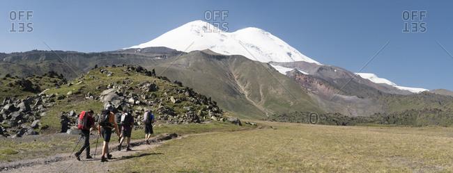 Russia- Caucasus- Mountaineers hiking in Upper Baksan Valley