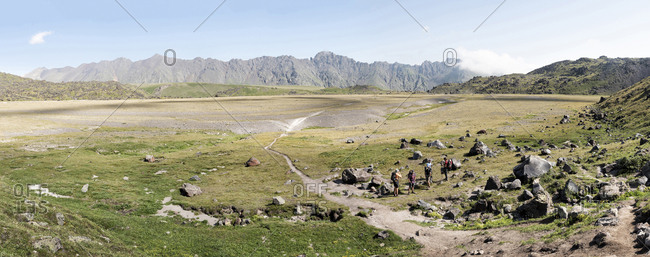 Russia- Caucasus- Mountaineers hiking in Upper Baksan Valley