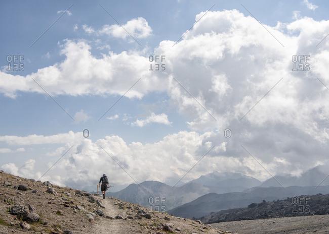 Russia- Caucasus- Mountaineer hiking in Upper Baksan Valley
