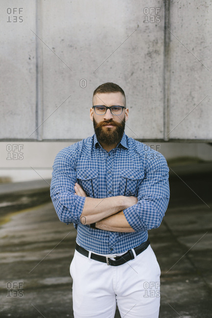 Portrait of bearded hipster businessman wearing glasses and plaid shirt