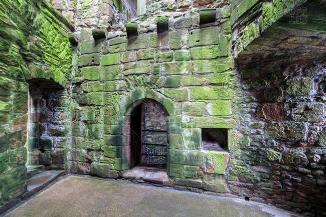 Great Britain- Scotland- Dumfries and Galloway- Caerlaverock Castle- green moss-grown wall