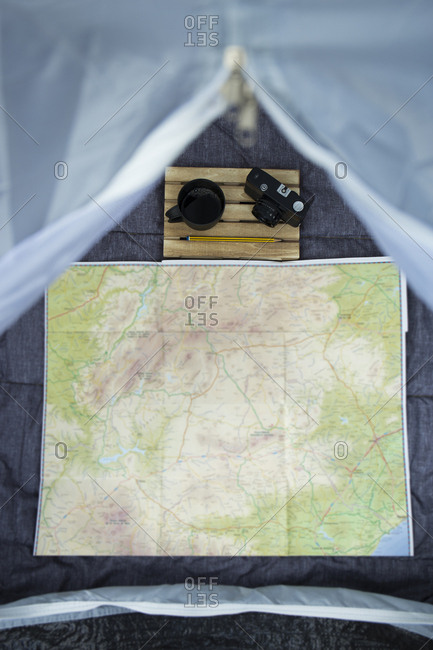 View into a tent with map- camera and