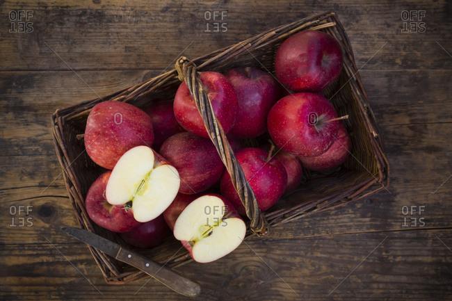 Red apples in basket- knife