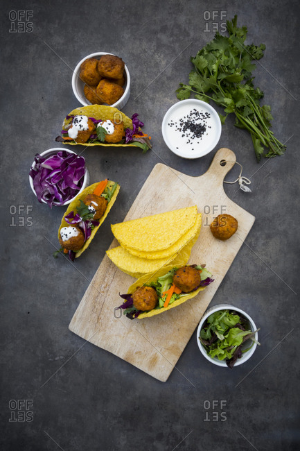 Sweet potato falafel in taco shells- with red cabbage- salad- carrot- yogurt sauce and black sesame